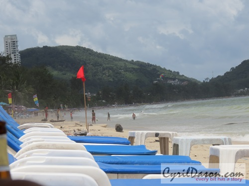 Empty beach chairs aligned at Patong beach