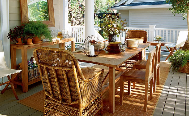 A nice patio design featuring wooden chairs